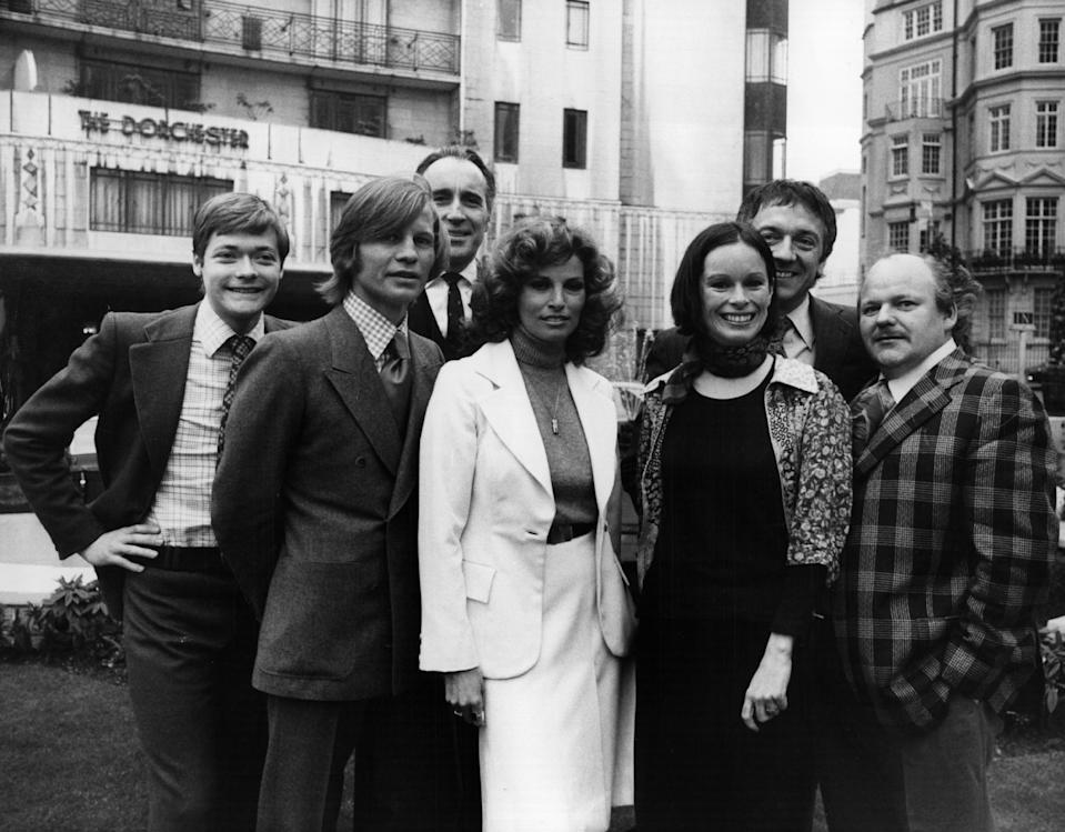 25th March 1974:  Stars of  the film 'The Three Musketeers' outside the Dorchester Hotel in London, where they gathered for a pre-release reception. They are, from left to right; Simon Ward, Michael York, Christopher Lee, Raquel Welch, Geraldine Chaplin, Jean Pierre Cassel and Roy Kinnear.  (Photo by Frank Barratt/Keystone/Getty Images)