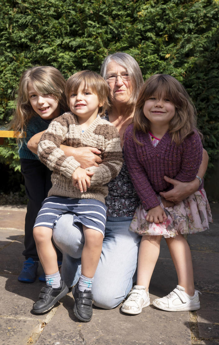 RETRANSMITTING ADDING AGES SURNAMES NOT GIVEN Susan reunited with her grandchildren, Emily 10 (left), Benjamin 4 (second left) and Daisy 7(right), in Ashtead, Surrey, for the first time following the introduction of measures to bring England out of lockdown, as people living alone in England can form support bubbles with other households from Saturday, ending weeks of isolation under lockdown.