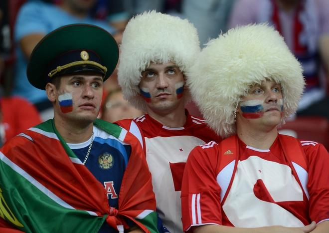 Russian fans react after the Euro 2012 championships football match Greece vs Russia on June 16, 2012 at the National Stadium in Warsaw.    AFP PHOTO / CHRISTOF STACHECHRISTOF STACHE/AFP/GettyImages