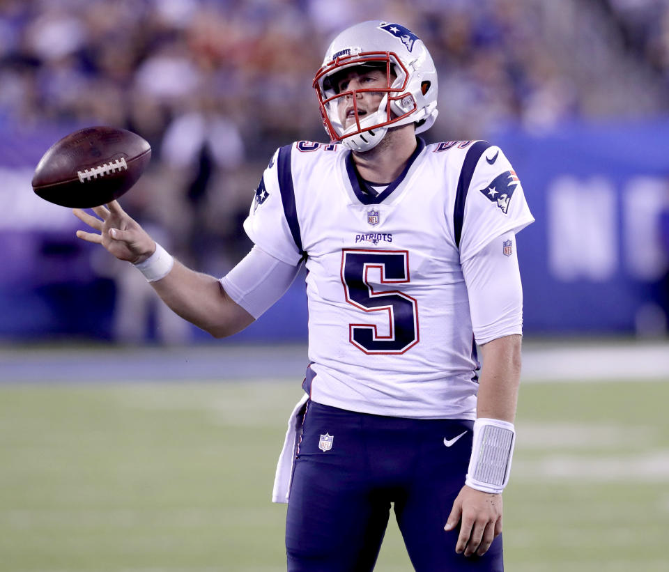 New England Patriots quarterback Danny Etling reacts after scrambling against the New York Giants during the first half of an NFL preseason football game, Thursday, Aug. 30, 2018, in East Rutherford. (AP Photo/Mark Lennihan)