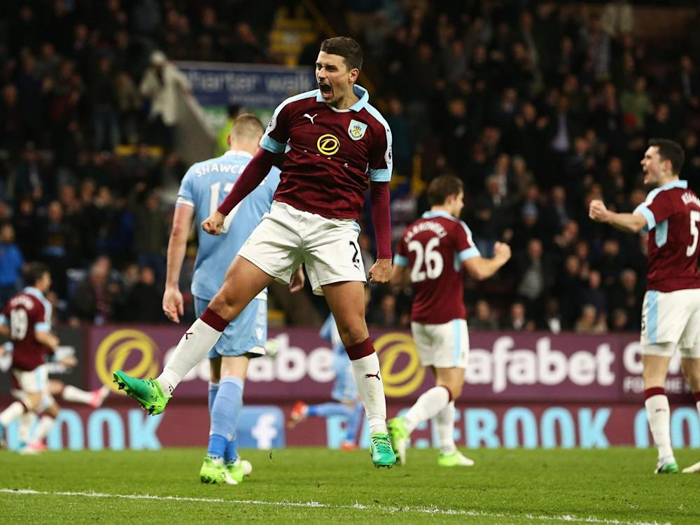 Matthew Lowton celebrates after the final whistle at Turf Moor (Getty)