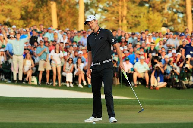 Justin Rose of England reacts to his missed putt on the first playoff hole during the final round of the 2017 Masters tournament, at Augusta National Golf Club in Georgia, on April 9 (AFP Photo/Andrew Redington)