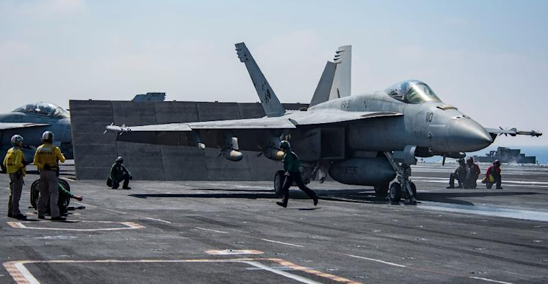 """An F/A-18E Super Hornet attached to the """"Tomcatters"""" of Strike Fighter Squadron (VFA) 31 on the deck of the Nimitz-class aircraft carrier USS George H.W. Bush to conduct flight operations in support of Operation Inherent Resolve on June 6, 2017"""