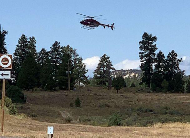 PHOTO: A helicopter flies near the scene where a tour bus crashed near Bryce Canyon National Park on SR-12 in Utah, Sept. 20, 2019. (Dallas Clark/St. George News)