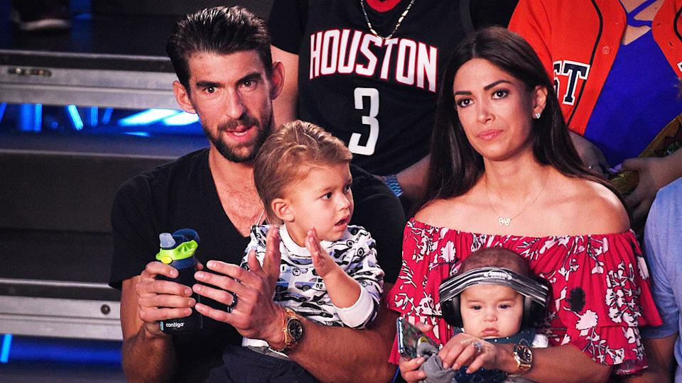 Michael and Nicole Phelps are seen here with two of their children at a sporting event.