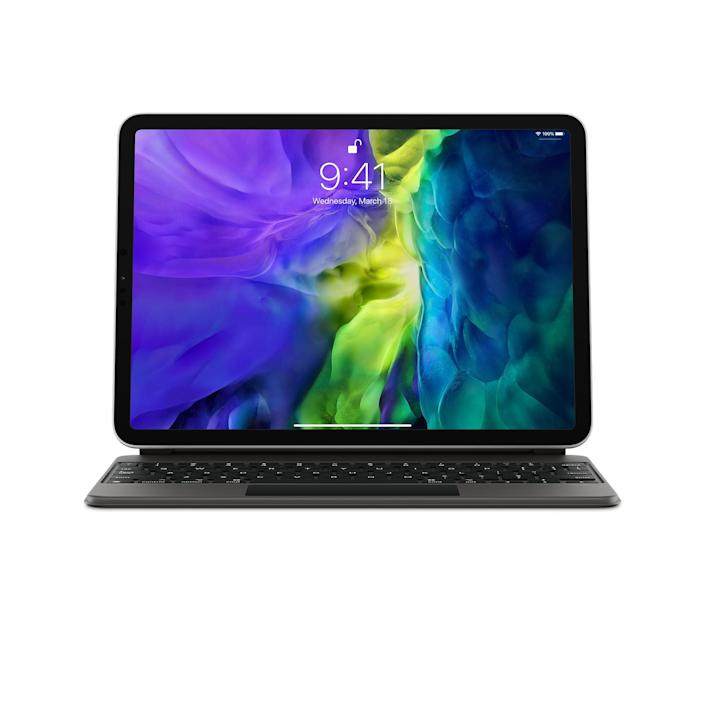 """<em>For the mom who is all about efficiency:<br></em><h2>iPad Magic Keyboard</h2>This new iPad Pro keyboard from Apple converts your iPad into a full-fledged laptop with a trackpad, a floating design that makes the screen easy to adjust, and the best typing experience ever made possible on an iPad. Ideal for the mom who can't be bothered to have devices in every room (and a pesky charger for each one).<br><br><strong>Apple</strong> Magic Keyboard for iPad Pro 11‑inch (2nd generation) - US English, $, available at <a href=""""https://go.skimresources.com/?id=30283X879131&url=https%3A%2F%2Fwww.apple.com%2Fshop%2Fproduct%2FMXQT2LL%2FA%2Fmagic-keyboard-for-ipad-pro-11%25E2%2580%2591inch-2nd-generation-us-english"""" rel=""""nofollow noopener"""" target=""""_blank"""" data-ylk=""""slk:Apple"""" class=""""link rapid-noclick-resp"""">Apple</a>"""