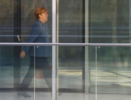 Merkel, leader of the Christian Democratic Union (CDU), arrives at Reichstag building before the start of exploratory talks about forming a new coalition government in Berli