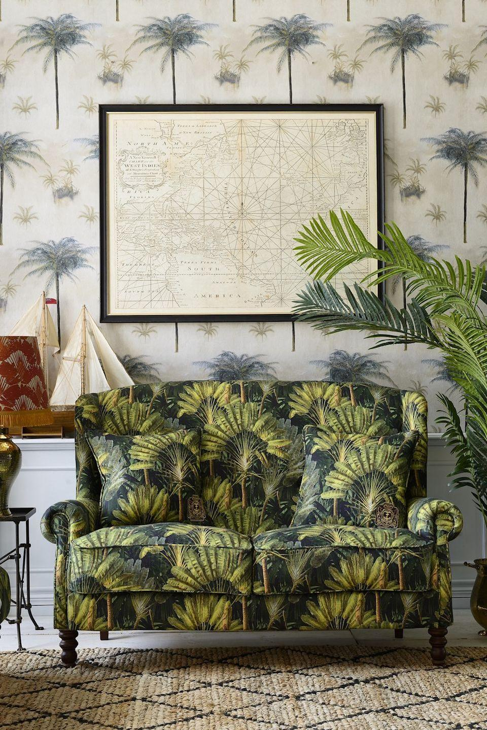 """<p>Bring relaxed holiday vibes to your living room with a wallpaper design which reflects soft tones and tropical elements, like this Caribbean-inspired large scale painted palm tree wallpaper. Here, dark contours of the palm stems blend with pastel greens and sandy shades of gold, in a hazy, calming composition.</p><p>Pictured: CAYO LARGO Wallpaper, <a href=""""https://mindtheg.com/uk/products/stories/the-tropical-cottage/cayo-largo.html"""" rel=""""nofollow noopener"""" target=""""_blank"""" data-ylk=""""slk:MINDTHEGAP"""" class=""""link rapid-noclick-resp"""">MINDTHEGAP</a></p>"""