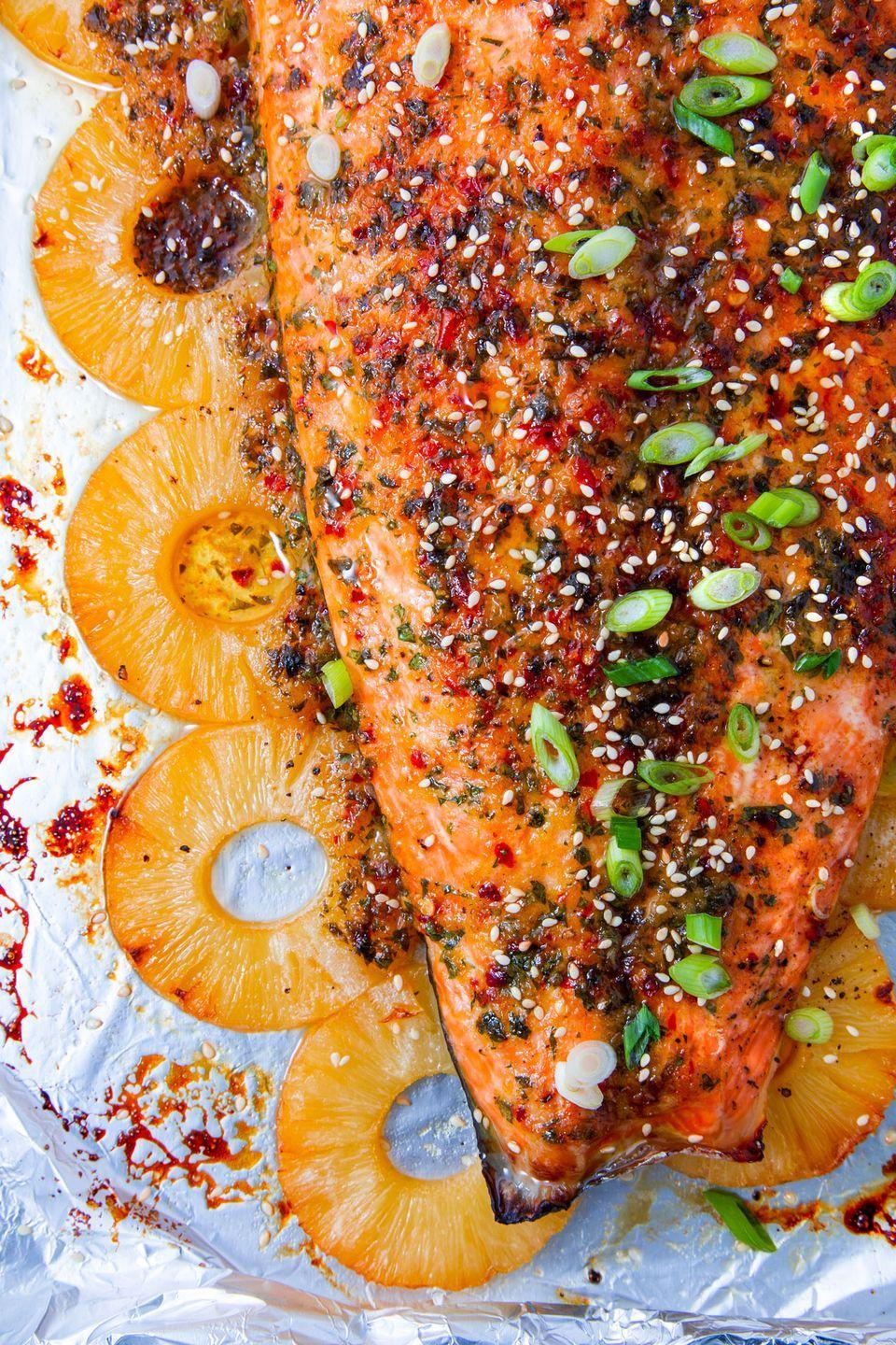 "<p>We never realized how badly we needed this. </p><p>Get the recipe from <a href=""https://www.delish.com/cooking/recipe-ideas/a26728380/baked-pineapple-salmon-recipe/"" rel=""nofollow noopener"" target=""_blank"" data-ylk=""slk:Delish"" class=""link rapid-noclick-resp"">Delish</a>. </p>"