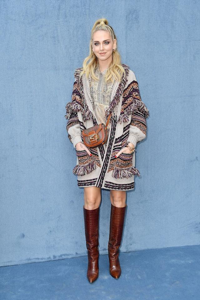 <p>The influencer wore a multicoloured cardigan and knee-high boots to the Etro show. </p>
