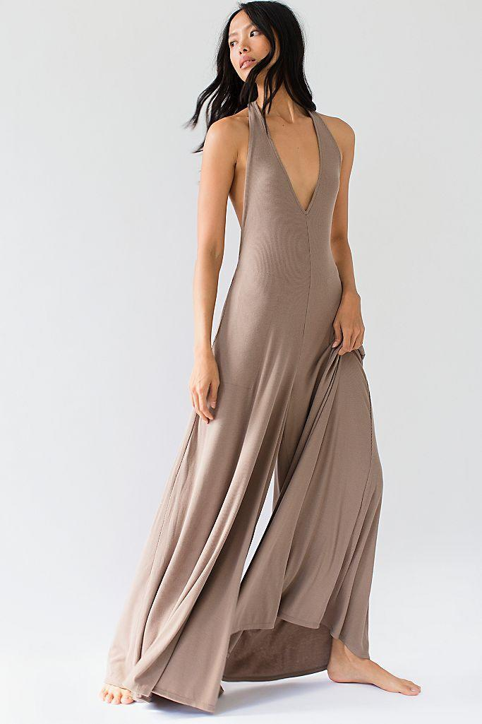 """<p>You can tell just from looking at its super flowy fabric that the Free People Leigh One-Piece was made for hardcore lounging. The halter-style silhouette and soft ribbed material are also ideal for those who prefer to forgo a bra and panties indoors. </p> <p><strong>Sizes available:</strong> XS to XL</p> <p><strong>$70</strong> (<a href=""""https://click.linksynergy.com/deeplink?id=MZ9491VLjxM&mid=43177&u1=AllureCozyLoungewear&murl=https%3A%2F%2Fwww.freepeople.com%2Fshop%2Fleigh-one-piece%2F%3F"""" rel=""""nofollow noopener"""" target=""""_blank"""" data-ylk=""""slk:Shop Now"""" class=""""link rapid-noclick-resp"""">Shop Now</a>)</p>"""