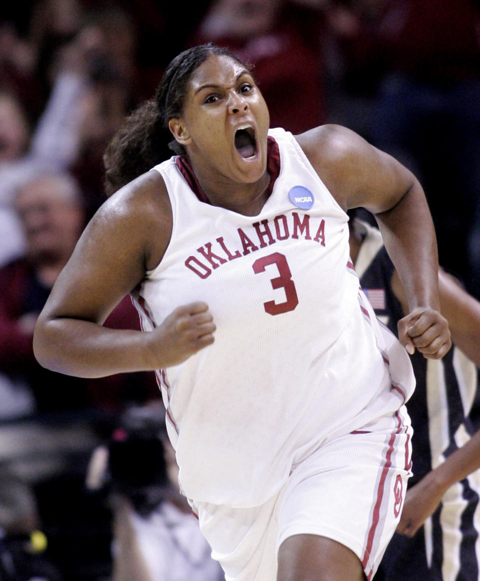 FILE - In this Tuesday, March 31, 2009, file photo, Oklahoma's Courtney Paris (3) reacts after scoring against Purdue in the second half of a women's NCAA tournament regional championship college basketball game in Oklahoma City. Paris, who left Oklahoma with 20 NCAA Division I records, is returning to Oklahoma as an assistant coach. (AP Photo/Sue Ogrocki, File)
