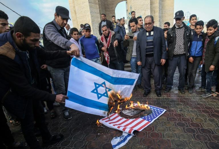 Palestinians demonstrated against the US plan in the West Bank and Gaza, with protesters burning Israeli and US flags on Saturday in the town of Rafah, in the Gaza Strip (AFP Photo/SAID KHATIB)