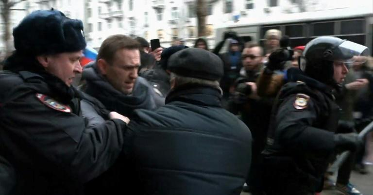 Alexei Navalny has been banned from running for president and was detained at a rally urging voters to boycott the vote