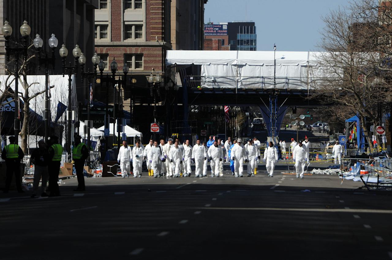 BOSTON, MA - APRIL 17: Workers prepare to take down barriers along Boylston Street near the scene of the Boston Marathon bombing April 17, 2013 in Boston, Massachusetts. Boston continues to return to normal, as businesses and streets are reopened following two bomb explosions at the finish line of the marathon that killed 3 people and injured over a hundred more. (Photo by Darren McCollester/Getty Images)