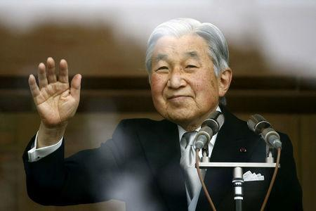 FILE PHOTO: Japan's Emperor Akihito waves to well-wishers who gathered at the Imperial Palace to mark his 82nd birthday in Tokyo, Japan, December 23, 2015. REUTERS/Thomas Peter/File Photo