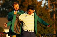 Hideki Matsuyama is awarded the Masters green jacket by 2020 champion and world number one Dustin Johnson