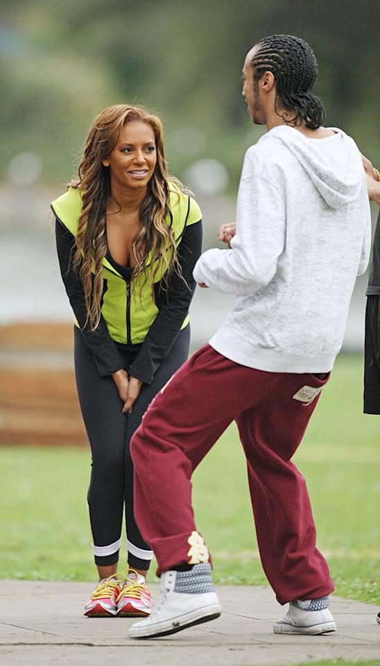 """Just call her Sweaty Spice! Former Spice Girl Melanie Brown had some help while exercising Wednesday at London's Regent's Park in her native England. After, she tweeted, """"Just did a regents park early morning work out with some of the guys from @fitnessfirstuk crazy I no,but good!!!"""" Trevor Adams/<a href=""""http://www.infdaily.com"""" target=""""new"""">INFDaily.com</a> - October 13, 2010"""
