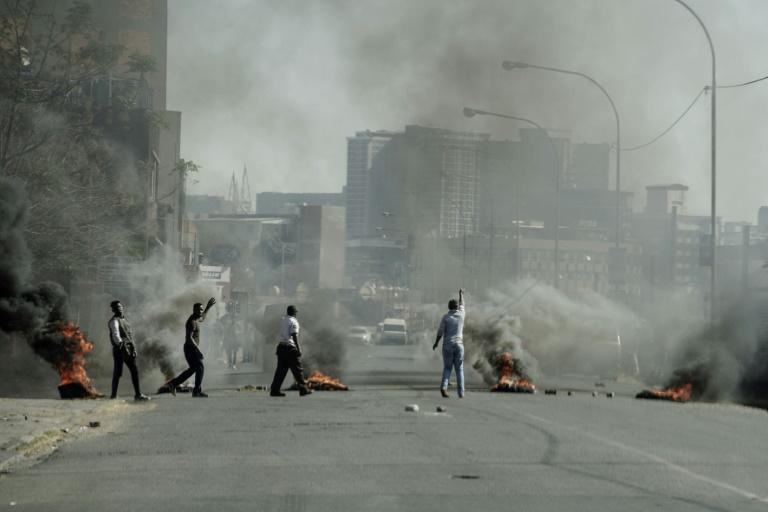 Some protesters set up barricades and burned tyres
