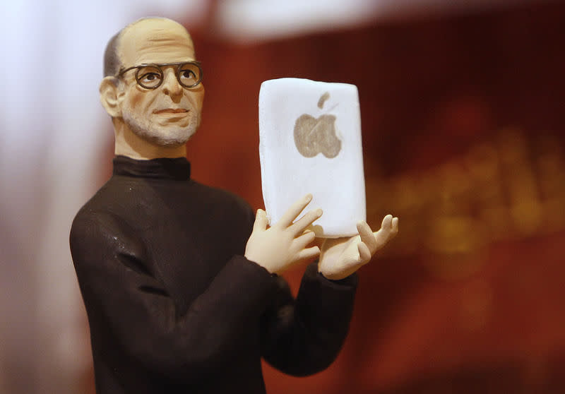A figure of Apple founder Steve Jobs is seen in a craft shop in Naples, Italy, in this October 7, 2011 file photo. REUTERS/Ciro De Luca/Files