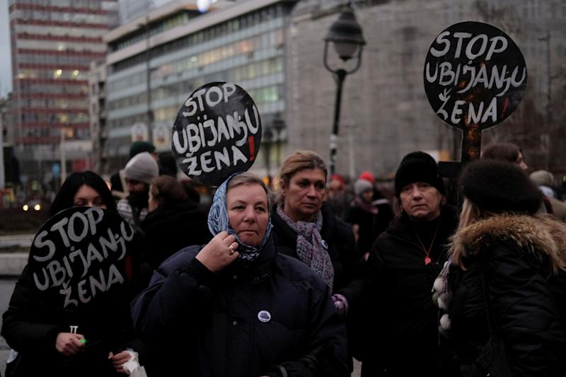 """Demonstrators hold banners reading """"Stop murdering women"""" during a march under the slogan """"Death to fascism, freedom to the women."""""""