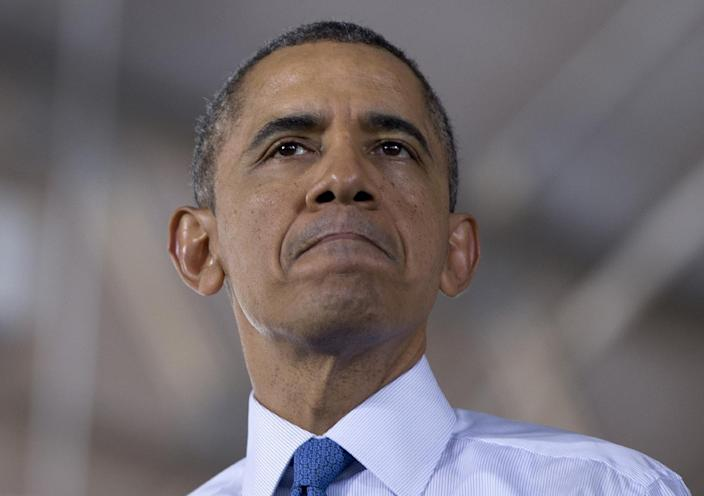 President Barack Obama pauses as he speaks about his proposal to raise the national minimum wage, Wednesday, April 2, 2014, at the University of Michigan in Ann Arbor, Mich., . (AP Photo/Carolyn Kaster)