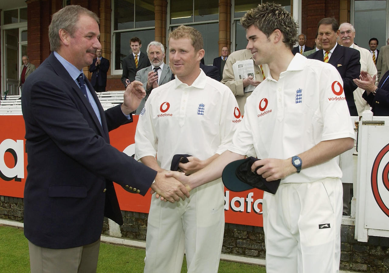 LONDON - MAY 22:  James Anderson of England receives his first cap from chairman of selectors David Graveney, as Anthony McGrath looks on during the first day of the first npower Test match between England and Zimbabwe at Lords Cricket Ground, on May 22, 2003 in London. (Photo by Tom Shaw/Getty Images)