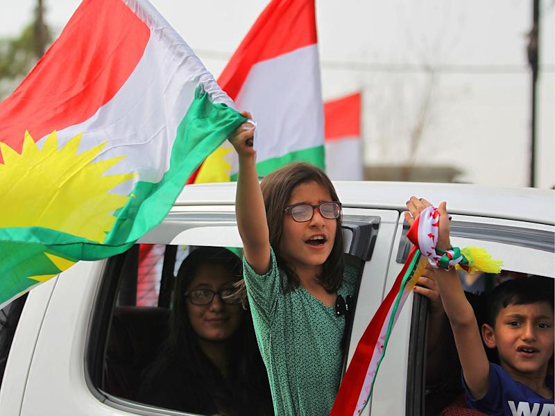 Iraqi children wave Kurdish flags in Kirkuk, but the vote has angered Baghdad and neighbours Turkey and Iran, where many Kurds live: AFP/Getty