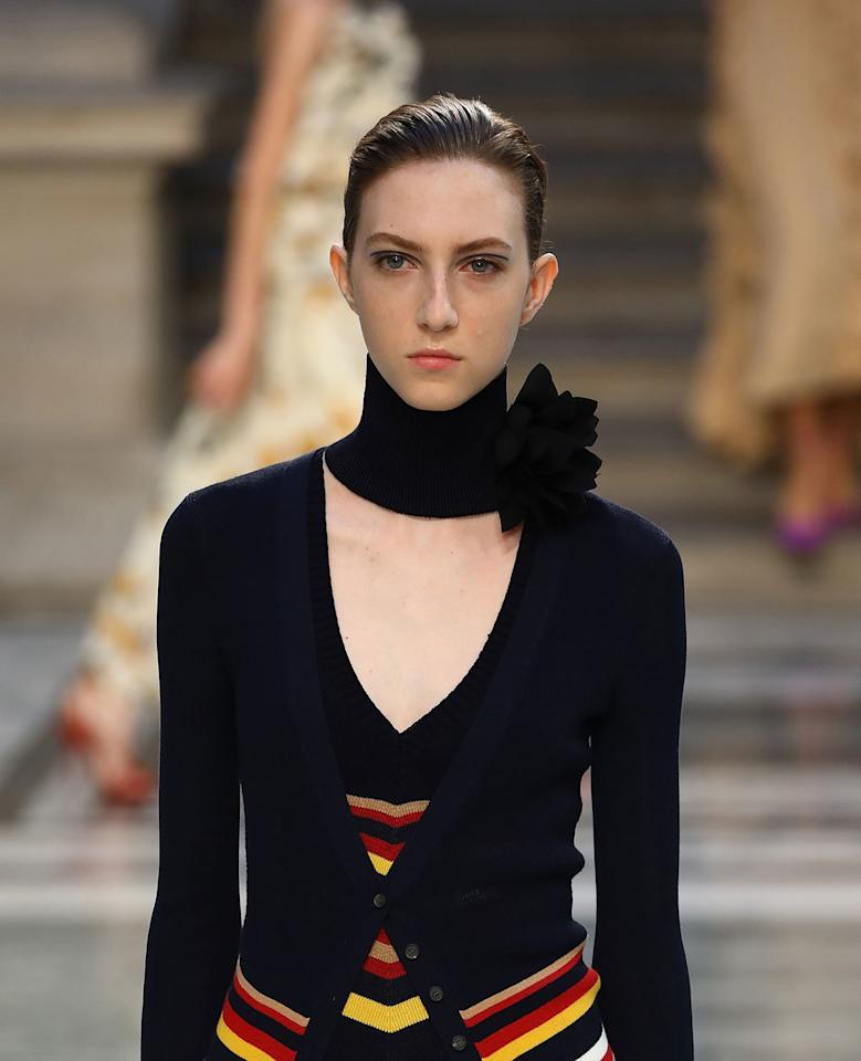 """<p><strong>THE LOOK: </strong>A subtle, yet colorful, eye look. Clean burgundy or navy lines were added just above the crease of the eye using products from Victoria Beckham's new beauty line. Hair was pulled back into super-slick low chignons by Redken Creative Director Guido Palau. </p> <p><strong>KEY PRODUCTS: </strong><a href=""""https://www.victoriabeckhambeauty.com/products/satin-kajal-liner?variant=bronze"""" target=""""_blank"""">Victoria Beckham Beauty Satin Kajal Liner</a> and <a href=""""https://www.victoriabeckhambeauty.com/products/smoky-eye-brick"""" target=""""_blank"""">Smoky Eye Brick</a>, and <a href=""""https://ulta.7eer.net/c/249354/164999/3037?subId1=IS%2CLFWBeauty%2Clukase%2C%2CIMA%2C3479909%2C201909%2CI&u=https%3A%2F%2Fwww.ulta.com%2Ffashion-work-12-hairspray%3FproductId%3DxlsImpprod6480987"""" target=""""_blank"""">Redken Fashion Work 12 Hairspray</a>. </p>"""