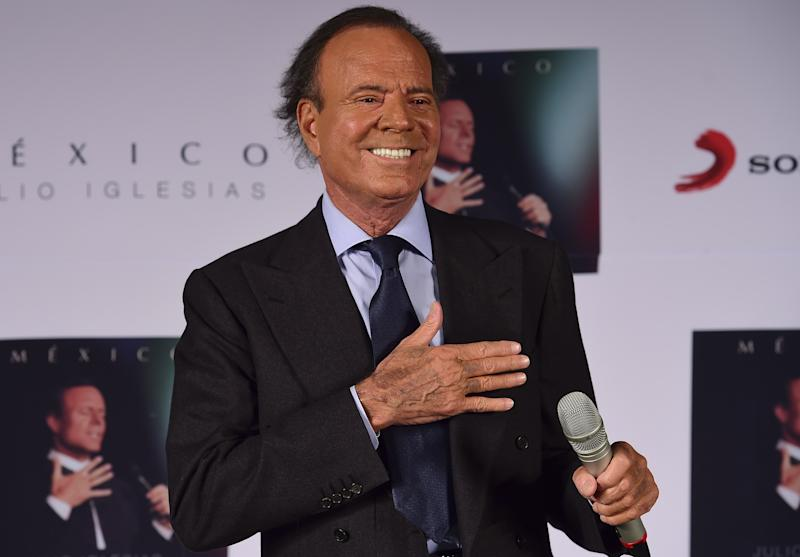 """Spanish singer Julio Iglesias gestures before a press conference in Mexico city, on September 23, 2015. Iglesias is in Mexico to promote his new album """"Mexico"""". AFP PHOTO/RONALDO SCHEMIDT (Photo credit should read RONALDO SCHEMIDT/AFP/Getty Images)"""