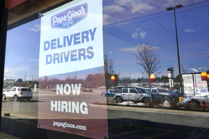 "A ""Now Hiring"" sign is displayed, Thursday, March 4, 2021, in Salem, N.H. After a year of ghostly airports, empty sports stadiums and constant Zoom meetings, growing evidence suggests that the economy is strengthening. Hiring picked up in February 2021. Business restrictions have eased as the pace of viral infections has ebbed. Yet the economy remains far from normal. (AP Photo/Elise Amendola)"