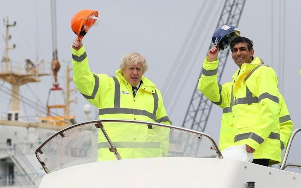 Prime Minister Boris Johnson and Chancellor of the Exchequer, Rishi Sunak aboard a boat on the River Tees during a visit to Teesport in Middlesbrough.