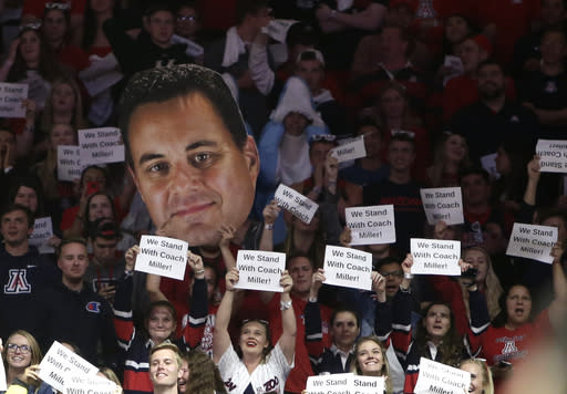 Fans in the Arizona student section hold up signs during the first half of the team's NCAA college basketball game against Stanford, Thursday, March 1, 2018, in Tucson, Ariz. (AP Photo/Rick Scuteri)