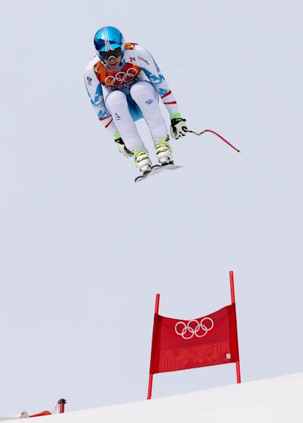 Austria's gold medalist Matthias Mayer jumps during the men's downhill at the Sochi 2014 Winter Olympics, Sunday, Feb. 9, 2014, in Krasnaya Polyana, Russia.(AP Photo/Luca Bruno)