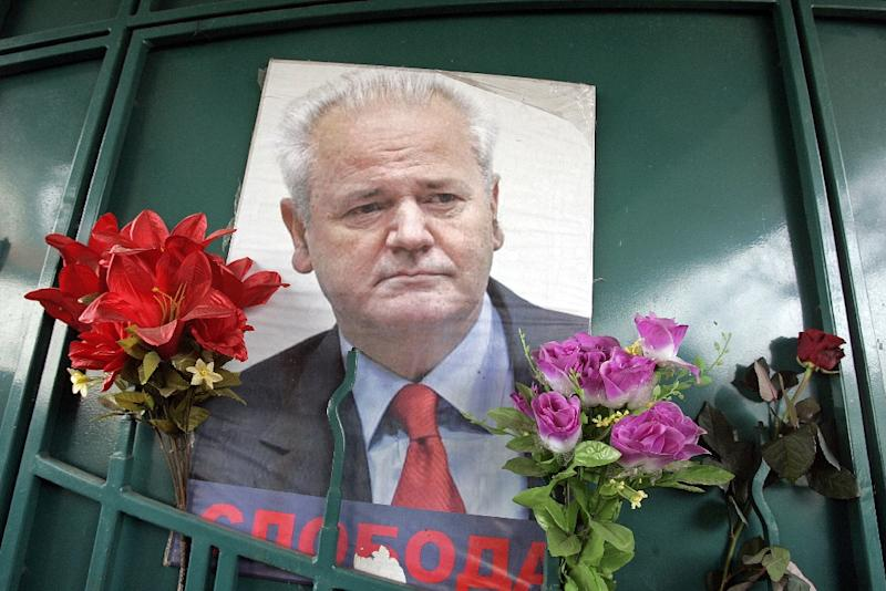 A picture near his grave in the town of Pozarevac shows Slobodan Milosevic the late former