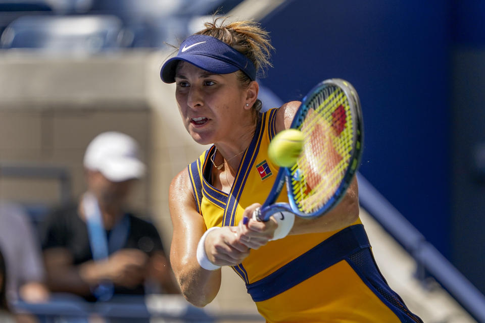 Belinda Bencic, of Switzerland, returns a shot to Emma Raducanu, of Great Britain, during the quarterfinals of the US Open tennis championships, Wednesday, Sept. 8, 2021, in New York. (AP Photo/Elise Amendola)