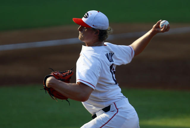 Georgia's Cole Wilcox throws a pitch during the fourth inning of the team's Southeastern Conference tournament NCAA college baseball game against Arkansas, Thursday, May 23, 2019, in Hoover, Ala. (AP Photo/Butch Dill)