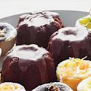 """<p><strong>Recipe: <a href=""""https://www.southernliving.com/syndication/mini-bourbon-cola-cakes"""" rel=""""nofollow noopener"""" target=""""_blank"""" data-ylk=""""slk:Mini Bourbon-and-Cola Bundt Cakes"""" class=""""link rapid-noclick-resp"""">Mini Bourbon-and-Cola Bundt Cakes</a></strong></p> <p>This classic cocktail combo is delightful in these mini cakes that are perfectly portable for fall events like church homecomings and tailgates.</p>"""