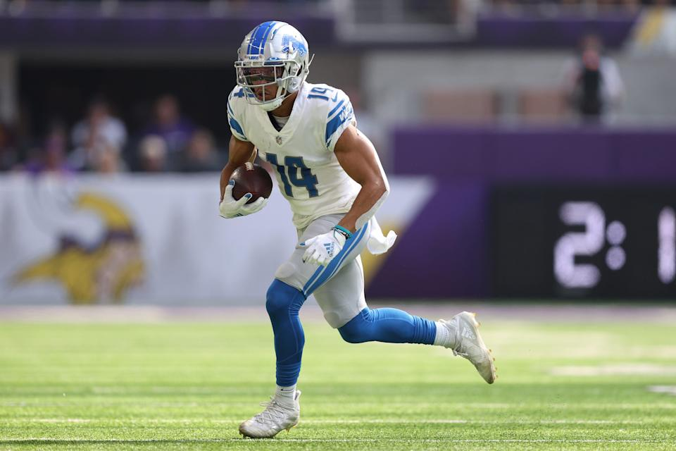 Lions wide receiver Amon-Ra St. Brown catches the ball for a first down during the first quarter against the Vikings on Sunday, Oct. 10, 2021, in Minneapolis.
