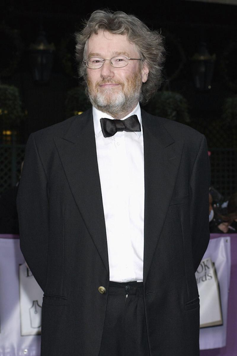 """FILE- Scottish author Iain Banks shown in this file photo dated April 7, 2004, who has revealed Wednesday April 3, 2013, that he has been diagnosed with late-stage gall bladder cancer and has just months to live. In a statement posted on his publisher's website Wednesday, 59-year-old fiction writer Banks said he is """"officially very poorly"""" and is considering chemotherapy to try to extend his life, but his latest novel is likely to be his last. (AP Photo / Yui Mok, PA, file) UNITED KINGDOM OUT - NO SALES - NO ARCHIVES"""