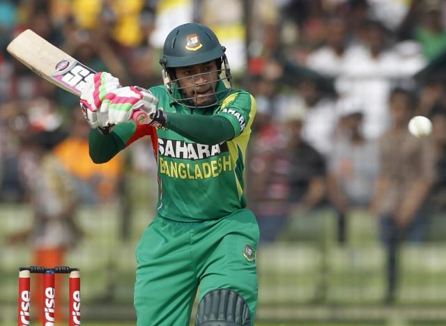 Bangladesh's captain Mushfiqur Rahim plays a ball against India during their Asia Cup 2014 one-day international (ODI) cricket match in Fatullah February 26, 2014. REUTERS/Andrew Biraj (BANGLADESH - Tags: SPORT CRICKET)