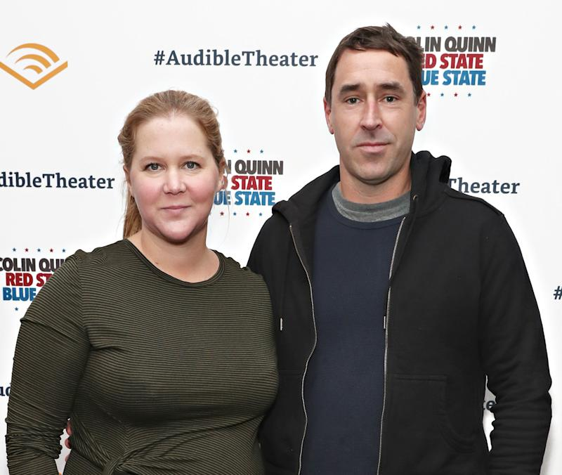 Amy Schumer and Chris Fischer attend the opening night of 'Colin Quinn: Red State Blue State' on Jan. 22 in New York City.