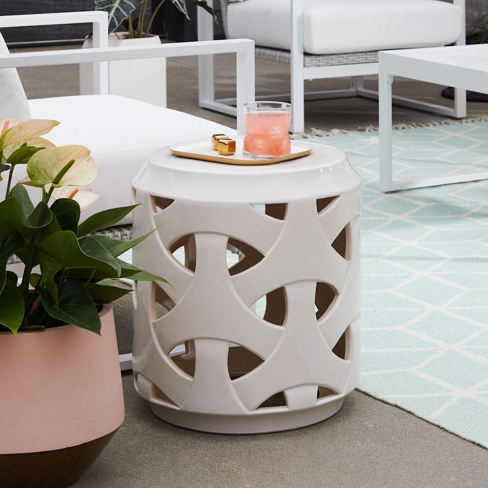 <p>How cute is this <span>MoDRN Retro Glam Ivory Embossed Outdoor Garden Stool</span> ($90)?</p>