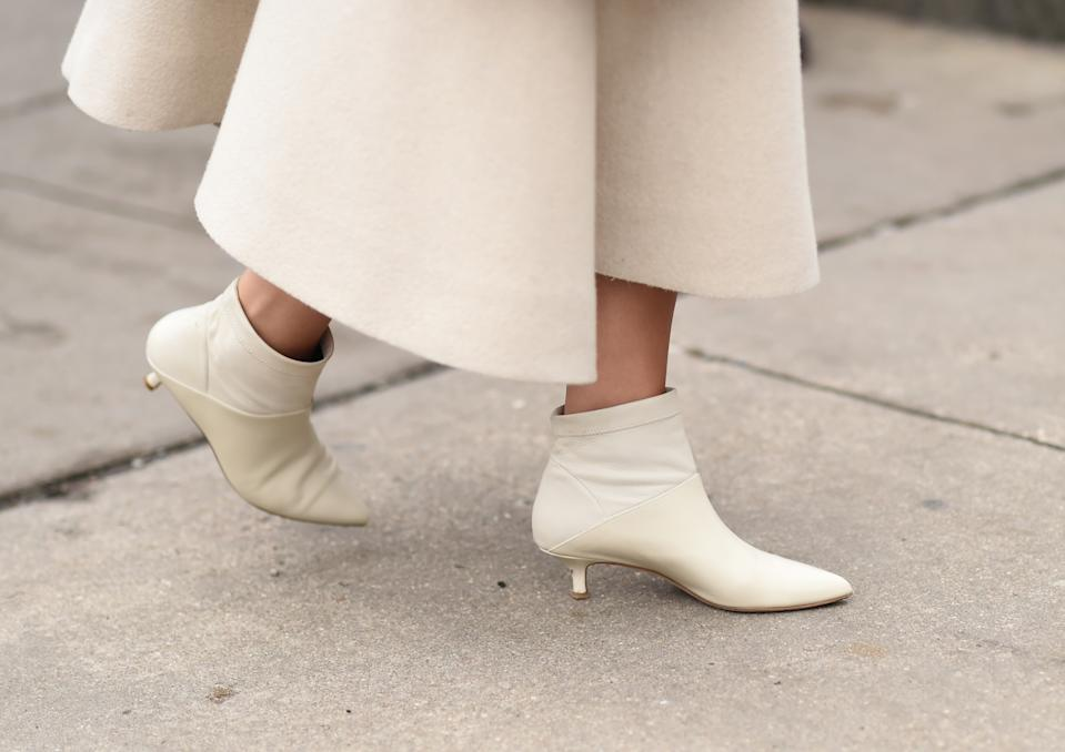NEW YORK, NEW YORK - FEBRUARY 07: A guest is seen wearing white booties outside the Tadashi Shoji show during New York Fashion Week: Women's Fall/Winter 2019 on February 07, 2019 in New York City. (Photo by Daniel Zuchnik/Getty Images)