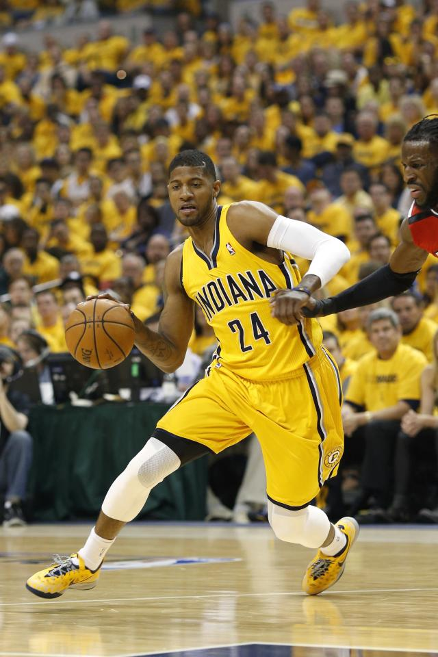 INDIANAPOLIS, IN - MAY 3: Paul George #24 of the Indiana Pacers drives to the basket against the Atlanta Hawks during Game Seven of the Eastern Conference Quarterfinals of the 2014 NBA Playoffs on May 3, 2014 at Bankers Life Fieldhouse in Indianapolis, Indiana. NOTE TO USER: User expressly acknowledges and agrees that, by downloading and or using this photograph, User is consenting to the terms and conditions of the Getty Images License Agreement. (Photo by Joe Robbins/Getty Images)