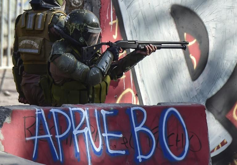Riot police in Chile take aim at protesters during anti-government demonstrations in Santiago on February 21