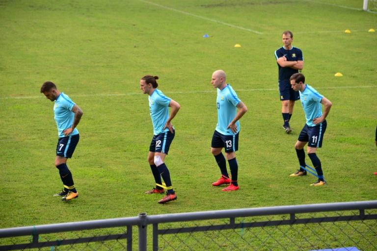 Australia's national team footballers (from L) Mathew Leckie, Jackson Irvine, Aaron Mooy and Craig Goodwin take part in a training session at Francisco Morazan stadium in San Pedro Sula, Honduras, on November 6, 2017