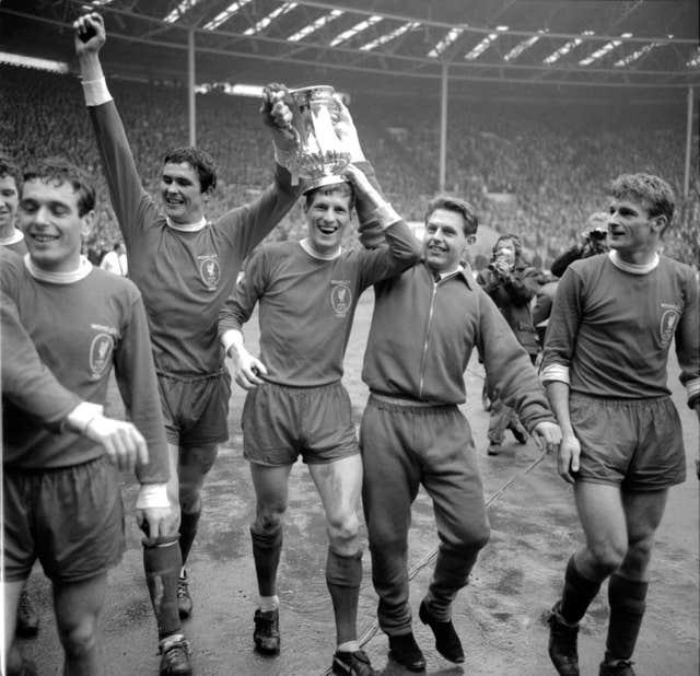 Liverpool's Ian Callaghan, Ron Yeats, Wilf Stevenson, Gordon Milne and Roger Hunt parade the FA Cup around Wembley in 1965