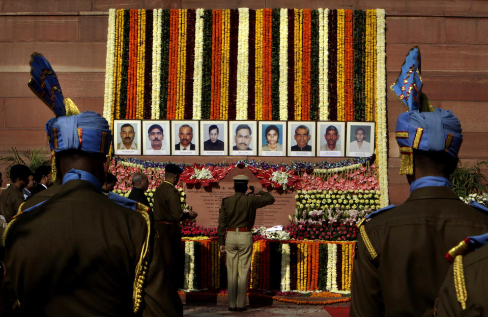 Indian paramilitary soldiers pay homage to the victims of the 2001 attack on the Indian parliament in New Delhi. (AP Photo/Manish Swarup)