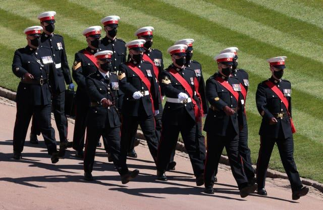 Members of the military march outside St George's Chapel